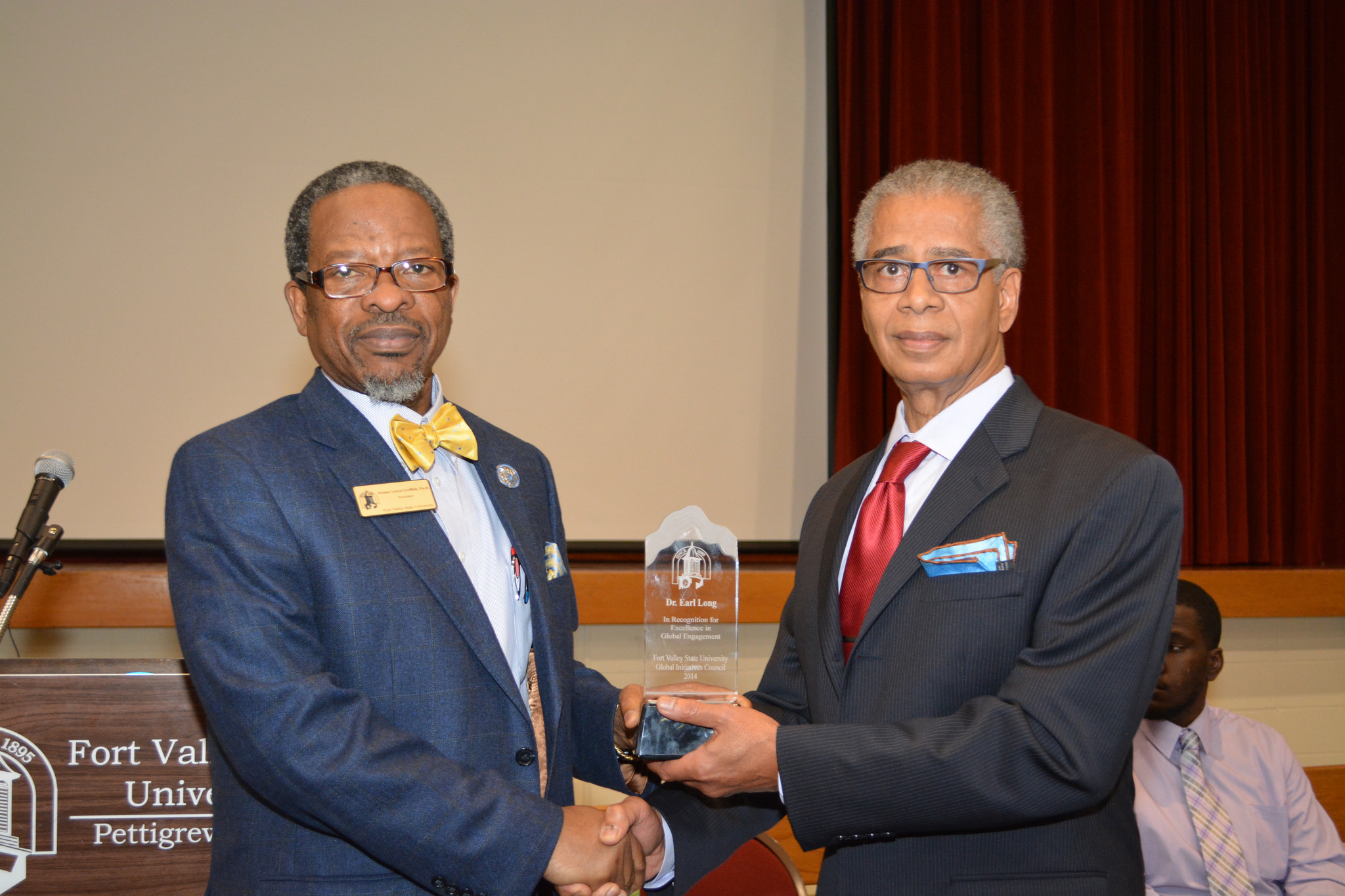 Dr. Earl Long (left) and President Ivelaw Lloyd Griffith