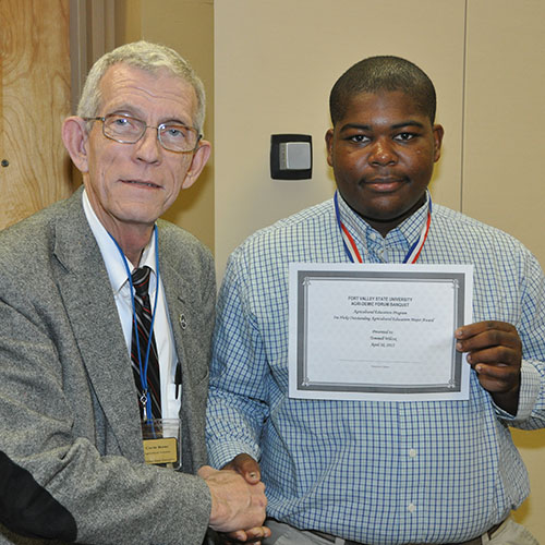 A student honored at FVSU's Agri-Demic Forum.