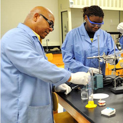 Dr. Dwayne Daniels, FVSU chemistry professor, in lab with students.