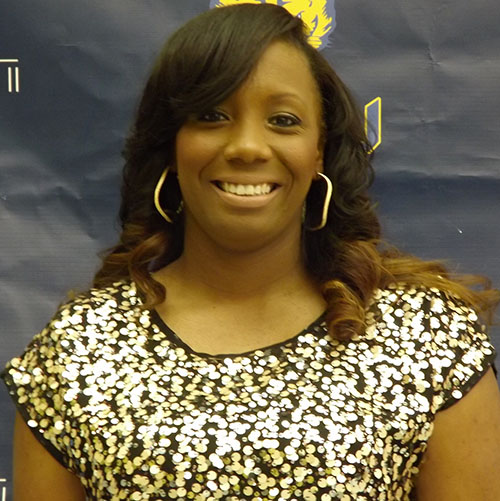 Erica Henry steps down as head woman's basketball coach.