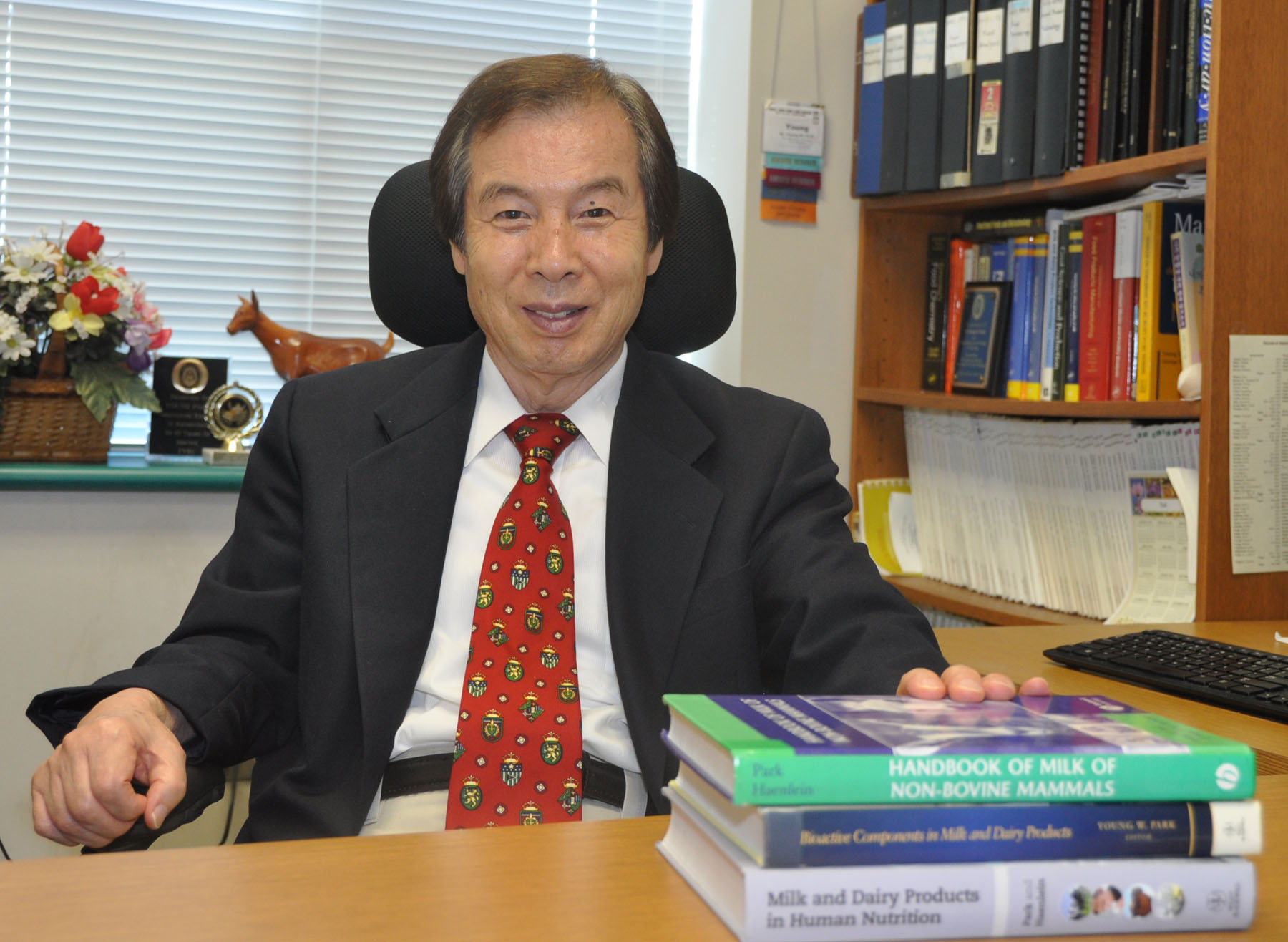 Dr. Young Park at his desk.