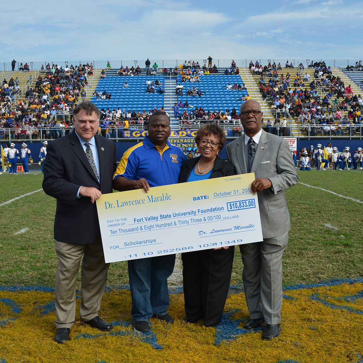 Dr. Lawrence Marable gives $10, 833 check to FVSU during Homecoming.