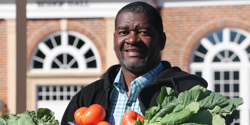 FVSU alum Brac Johnson with vegetables