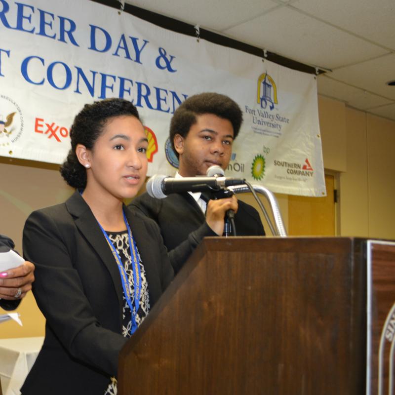 FVSU CDEP students standing at a podium