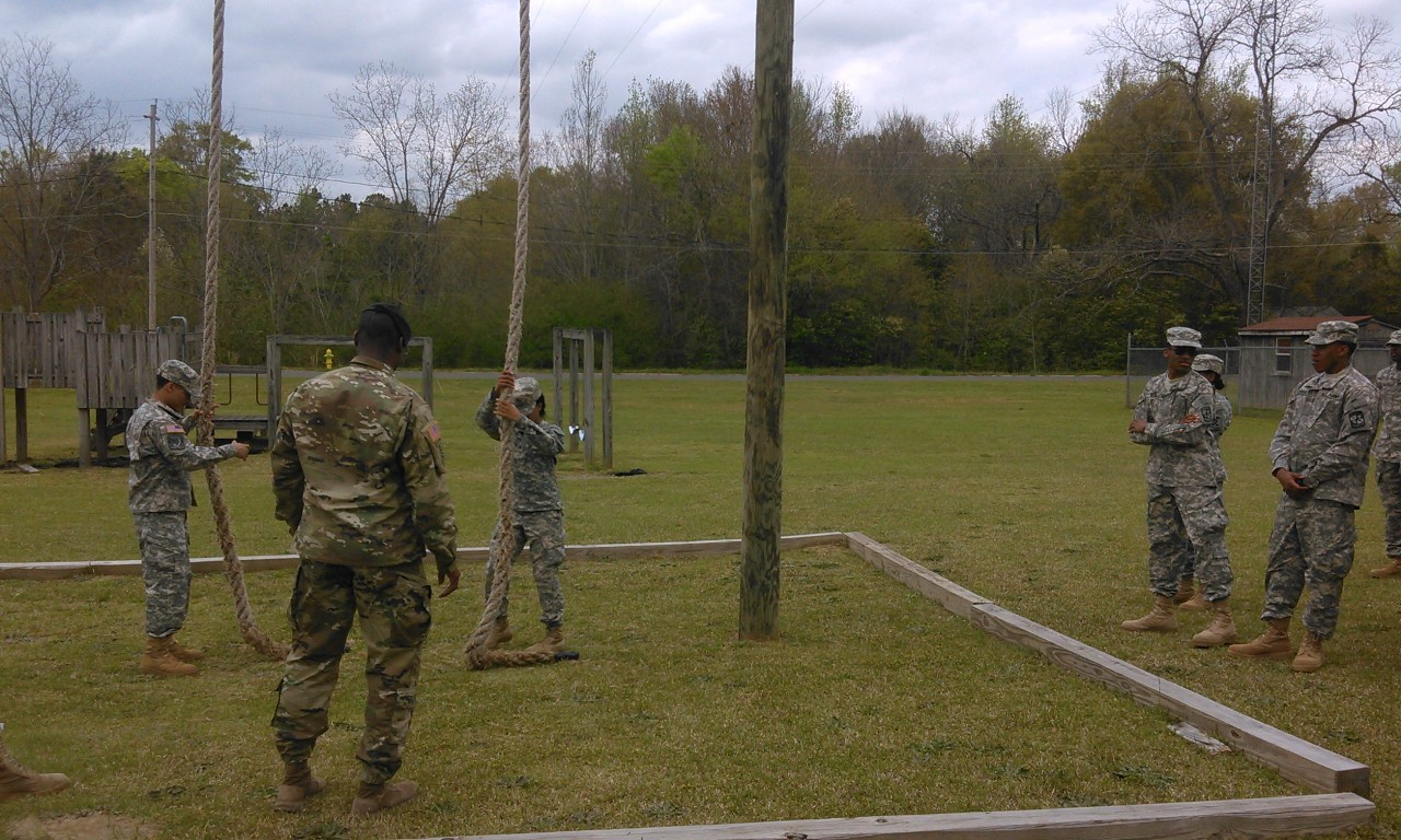 ROTC students participate in rope climbing exercise.