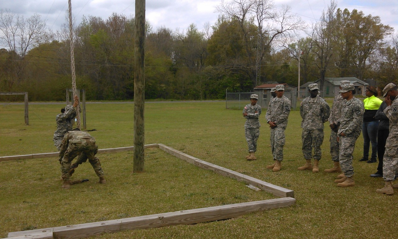 ROTC student climbs rope.