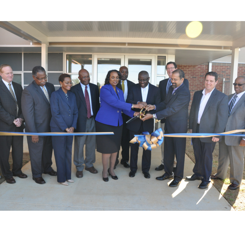 Fort Valley State University administrators and representatives from International City Builders, Stevens and Wilkinson Architecture and the University System of Georgia Board of Regents, participate in the official ribbon cutting ceremony for the Family Development Center and Quality Child Care Center Complex on March 3 in Fort Valley.