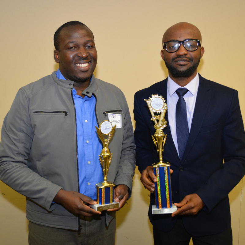 Students accept awards at the 2015 Research Day event.