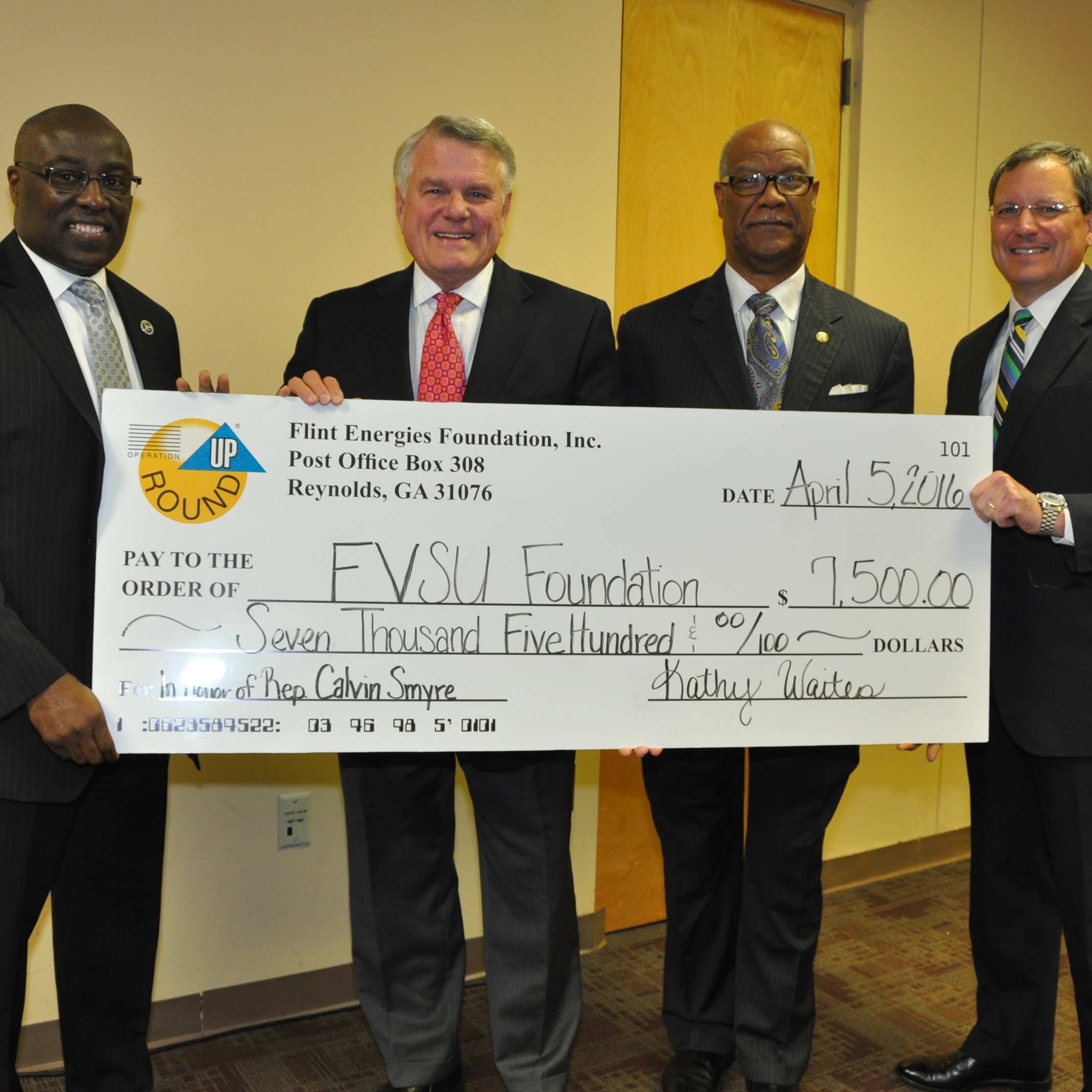 Flint Energies Foundation gives a check to the FVSU Foundation of $7,500.