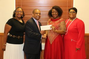 On behalf of the students, FVSU Provost T. Ramon Stuart, Ph.D., and instructor Juone Brown accept a $500 book scholarship from Delta Sigma Theta Sorority, Inc.