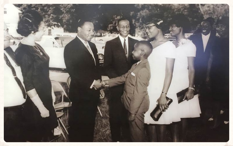 Dr. Martin Luther King, Jr. visits Fort Valley State College, 1966. Pictured standing next to President Troup (middle).